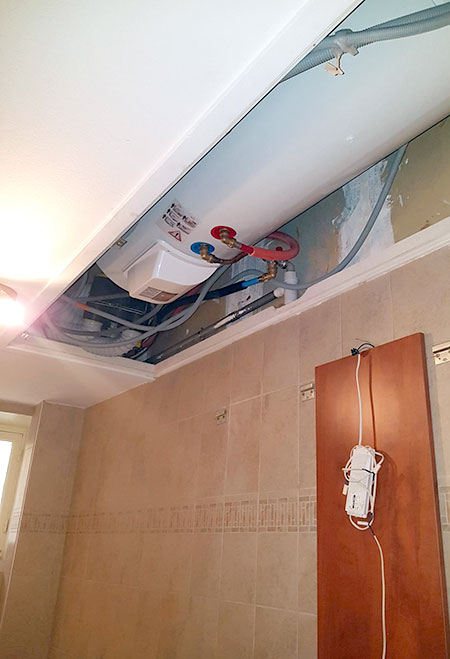 Intégration du chauffe-eau dans le faux-plafond
